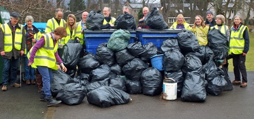 Photo fo some of the volunteers with some of the rubbish collected