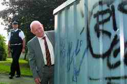 G&NM CSG Vice-Chairman Ian Wallace and Sergeant Andrew Verreydt inspect some grafitti in Westhill